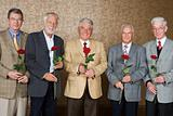 Senior men with roses