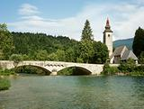 Bridge and church at lake bohinj slovenia
