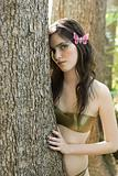 Young woman by tree