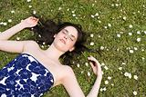 Young woman lying on grass