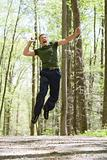 Man jumping for joy in forest