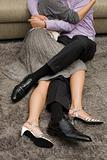 Young couple hugging on floor