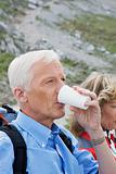 Hiker having a drink