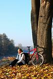 Happy woman cyclist enjoy the recreation autumn in nature