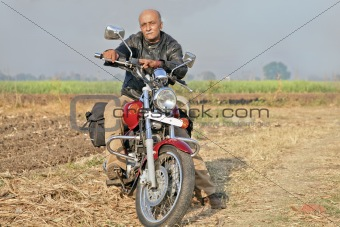 Rural Landcape with senior citizen on a motorcycle