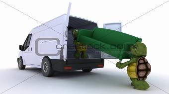 tortoises loading a sofa into a van
