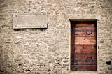 Wood door on stone wall