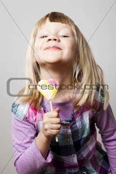 Little girl with lollipop