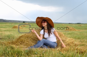 Smiling brunette girl in hat