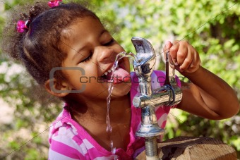Young Girl Drinks From Park Water Fountain