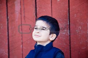 Little Boy Joyfully Gazing Up at the Sky