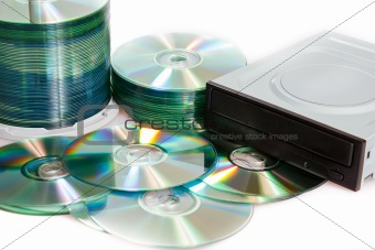 compact discs and burner on a white background
