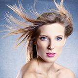 Fashion portrait of beautiful woman with streaming hair