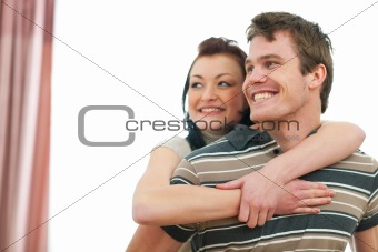 Portrait of smiling young couple looking on copyspace