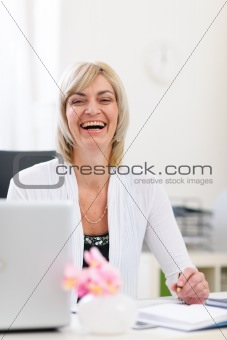 Portrait of smiling senior business woman at office