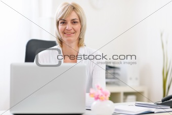Portrait of happy senior business woman at office