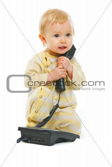Adorable baby with phone isolated on white
