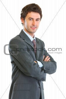 Portrait of modern business man with crossed hands