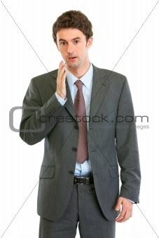 Portrait of shocked businessman