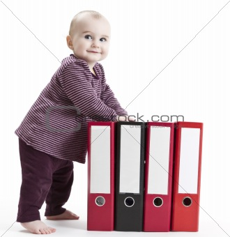 young child with four file folders