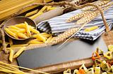 Rustic wooden board with pasta assortment