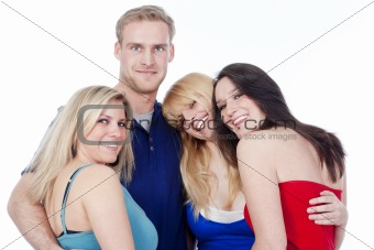 four young friends embracing, smiling, looking at camera - isolated on white