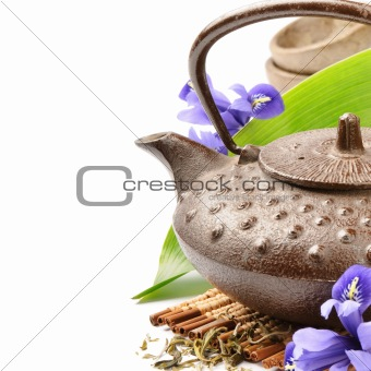 Asian tea set with green leaf and flowers