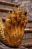 Detail of Golden Hand with five heads from a Statue in The Temple of Emerald Buddha (Wat Phra Kaew). Bangkok