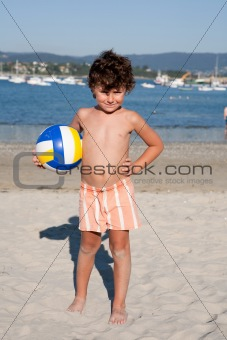Beautiful little boy on the beach