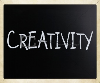 "The word ""Creativity"" handwritten with white chalk on a blackboa"