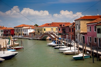 Canal with colorful houses / Italy / nobody