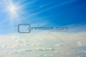 Blue Sky with Cumulus Clouds and Sun