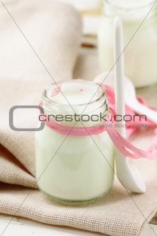 fresh natural yoghurt in glass jar