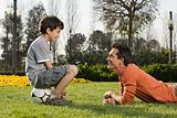 Boy and father in park