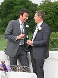 Best man and the groom laughing