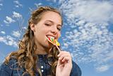 Teenage girl eating a lollipop