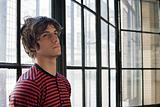 Teenage boy leaning against window