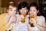 Portrait of friends drinking beer