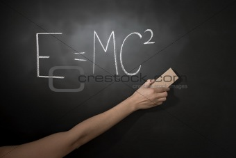 Teacher cleaning blackboard
