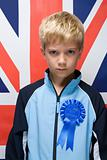 Boy wearing a rosette