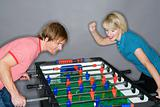 Young couple playing table football