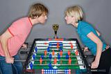 Man and a woman playing table football