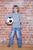 A boy holding a football