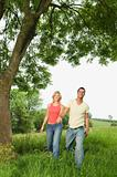Couple walking through countryside