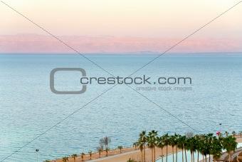 early pink sunrise on Dead Sea coast
