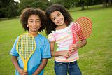 Girl and boy with tennis rackets