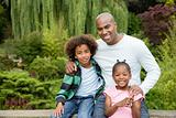 Father and children in park