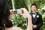 Groom being photographed