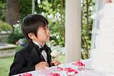 Boy looking at wedding cake
