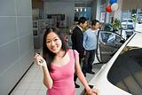 Woman in car dealership